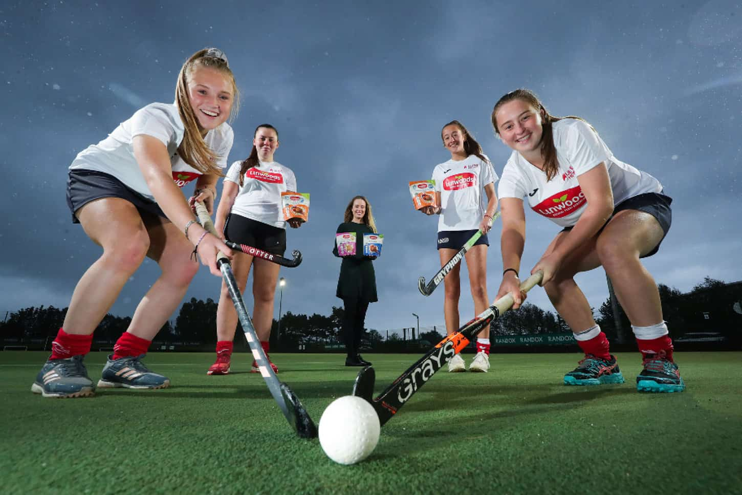 U18 Ulster Hockey players Olivia Beattie, Niamh Hogan, Emma Uprichard and Ella Armstrong are pictured with Ellen Woods, marketing executive at Linwoods.